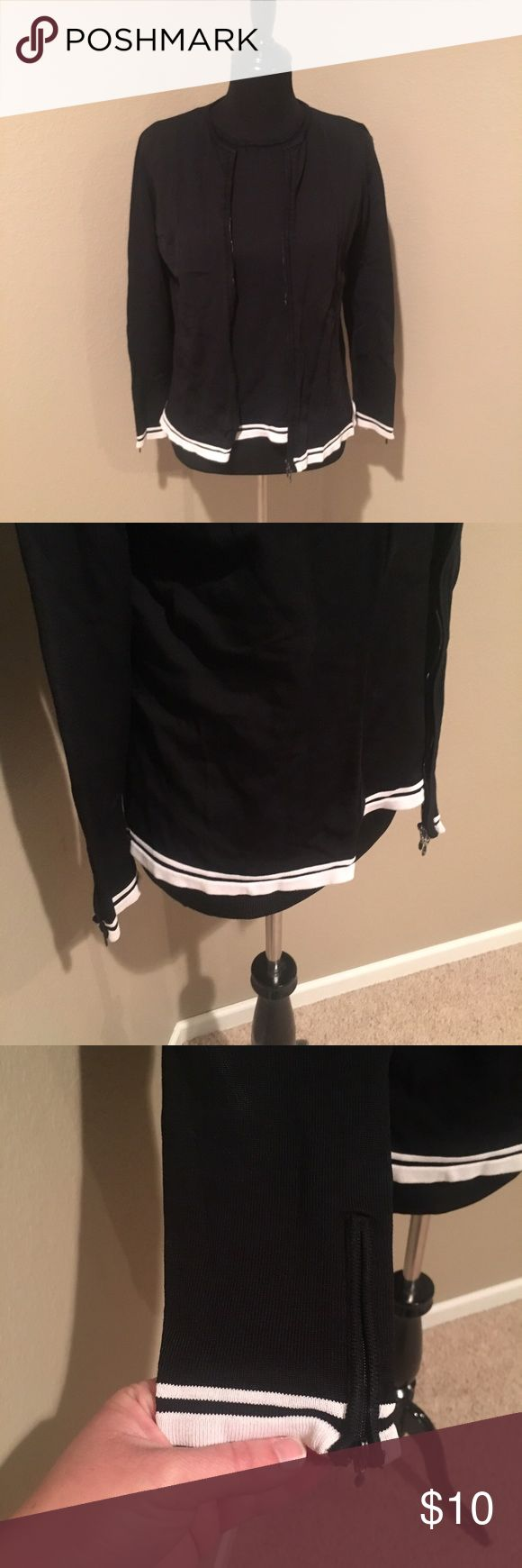 Black / white zip up cardigan set Black and white zip up cardigan and shell set. Zips all the way up with zippers on the sleeves. Zippers are missing a little of the paint and one small snag on shoulder as shown. Rayon / nylon blend. Casual Corner Sweaters Cardigans