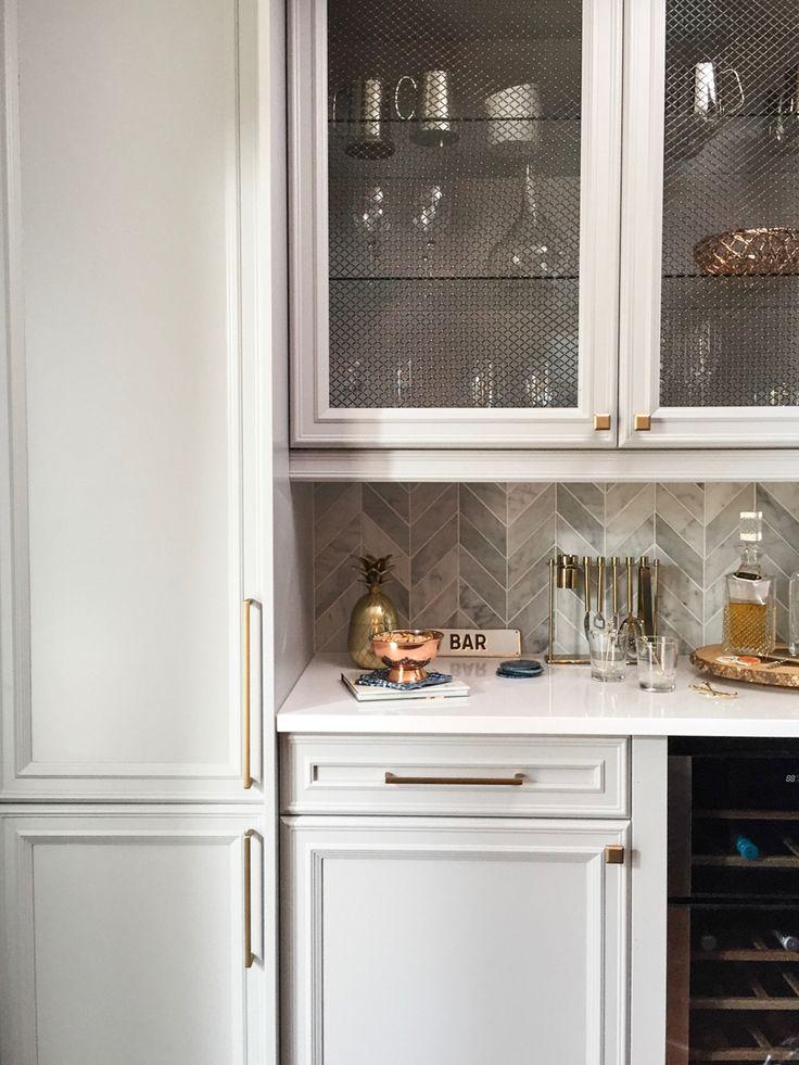 putty grey cabinets, chevron backsplash, megs grate cabinet doors.