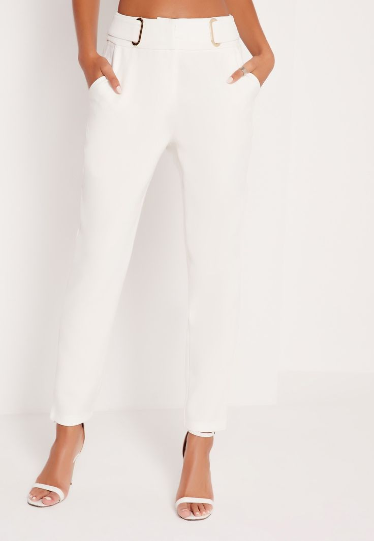 Slay all day and kill it all night in these cool white cigarette trousers. These totally trill trews will have you turnin' heads and raisin' pulses. With front zip fastening, a sleek tailored leg and D ring detailing, you gotta pair it ...
