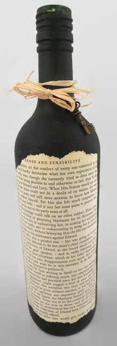 A standard glass Wine bottle hand painted in Black.  Decorated with an aged book page from Sense and Sensibility by Jane Austin. Finished with Raffia
