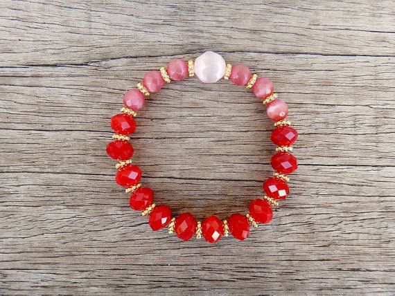 Alice Bracelet  Handmade bracelet with pink cat eye stones , red crystal beads and in between each bead there is a gold plated brass bead.     Our Items