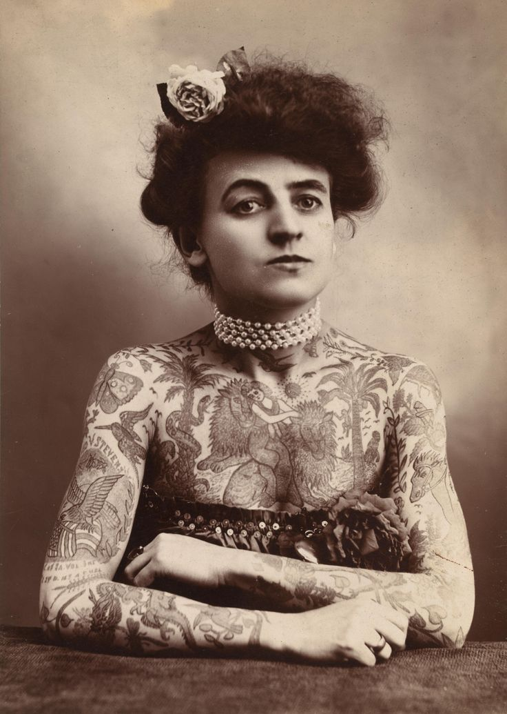 1907 woman with tattoos. unknown photographer