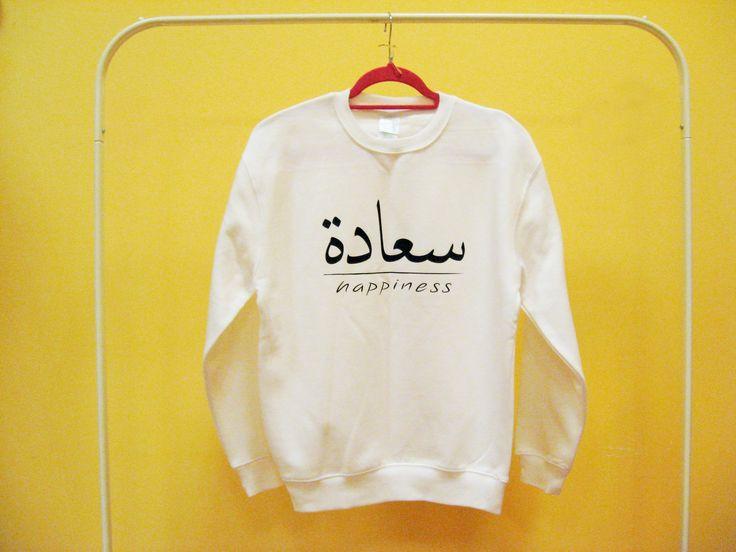 """Bluza """"Happiness"""" czyli """"Radość, Szczęście"""" 99zł Napis w języku arabskim.  Rozmiar S i M Wymiary: S 54/66 cm M 57/69 cm  Koszt wysyłki 10zł listem poleconym.  W celu zakupu prosimy o kontakt przez prywatną wiadomość na facebooku bądź email: bertness@email.com  """"Happiness"""" sweatshirt with arabic writting 29 € Size: small & medium  Dimensions: S 54/66 cm M 57/69 cm"""