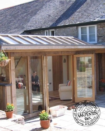 Green Oak and Glass Conservatory Extension with Roof Lantern in Cornwall by Carpenter Oak Ltd