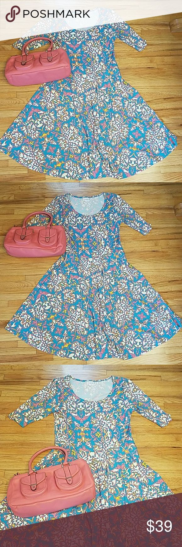 Lularoe Nicole Dress XL Turquoise & Coral Floral Lularoe Nicole Dress XL Turquoise & Coral Floral dress. Beauty of a dress ready for anything. Great stretch and arms are awesome not tight. Matching Purse is also for sale in my closet. See Lularoe sizing, ask questions and Happy Poshing! LuLaRoe Dresses Midi