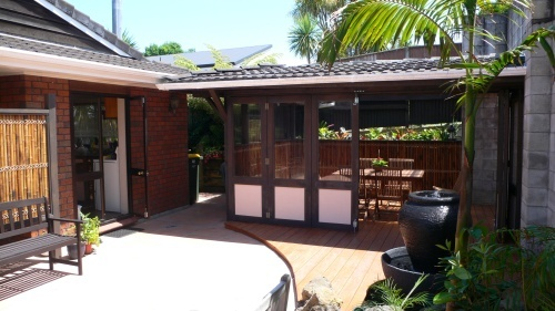 Old spa room converted into outdoor dining room. Designed by Fusion Landscape Design.
