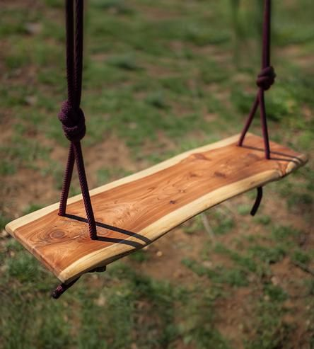 Take a seat on this cedar wood slab swing. With a sculpted, live edge and organic shape, the wood swing looks like a part of the tree it'll hang on. Find the perfect branch, wait for a cool breeze and get swinging.