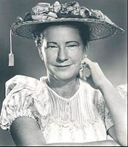 Sarah Ophelia Colley Cannon (October 25, 1912 – March 4, 1996), known professionally as Minnie Pearl, was an American country comedienne who appeared at the Grand Ole Opry for more than 50 years. She was an important influence on younger female country music singers and rural humorists such as Jerry Clower, Jeff Foxworthy, Bill Engvall, Carl Hurley, David L Cook, Chonda Pierce, Ron White and Larry the Cable Guy. In 1992, she was awarded the National Medal of Arts.
