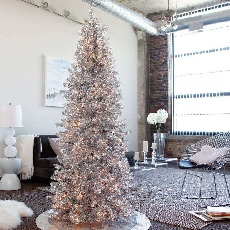 I love the elegance of the silver tree and white ornaments. modern-christmas -