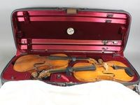 A 19th Century violin by Hopf with 2 piece back together with 1  other violin and a bow, both contained in a fibre carrying case SOLD FOR £240