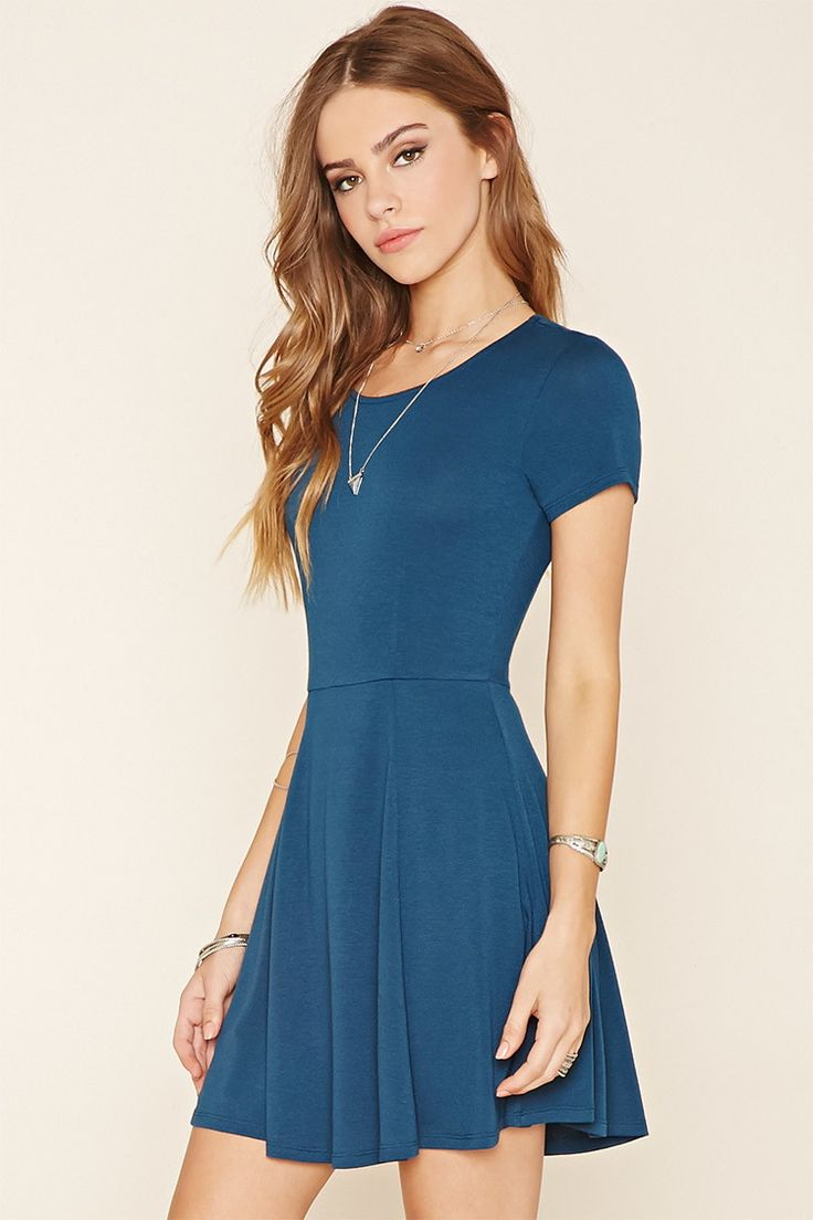 A stretch knit skater dress featuring a round neckline, short sleeves, and a cutout back.