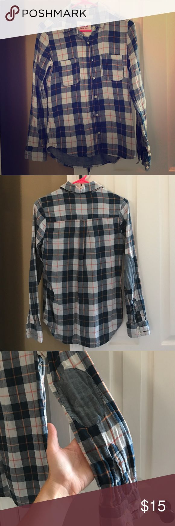 Mossimo button up plaid shirt with elbow patches Mossimo button up plaid shirt with elbow patches. This fun shirt can be worn alone or used to layer. Two tones of blue denim with cream blocks and orange and red plaid. Mossimo Supply Co Tops Button Down Shirts