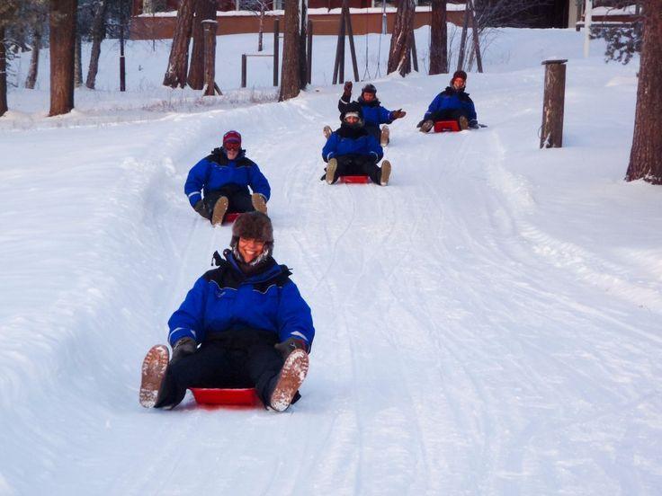 Tobogganing alongside the Korpikartano Lodge #Inari #ScanAdventures
