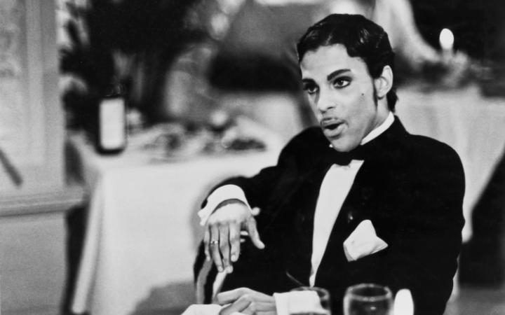 In 1986, Prince starred in the musical drama Under the Cherry Moon as a gigolo who, along with his partner (Jerome Benton), cons wealthy French women out of their money - until he falls in love with an heiress (played by Kristen Scott Thomas). The film was a flop (and won five Golden Raspberry awards) but the soundtrack was widely praised and yielded the number one hit Kiss.