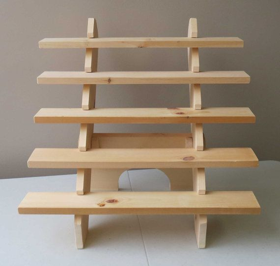 5-Shelf display stand: 20.5 high x 24 wide x 19.5 deep Each shelf: 24 wide x 3.5 deep 3.5 between each shelf (4.5 from table to first shelf) Assembles in less than 30 seconds with ease. See our video showing how easy it is to assemble our portable display stand: https://www.youtube.com/watch?v=8qhA3klSWoo Save space on your table by displaying your products vertically! Our handmade, portable, no-tools-required, flexibly stored, wooden display stand also adds height and thus interest to…