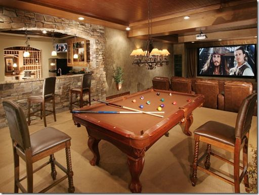 Idea for when we do our basement. I do LOVE the stone arch with the bar area.