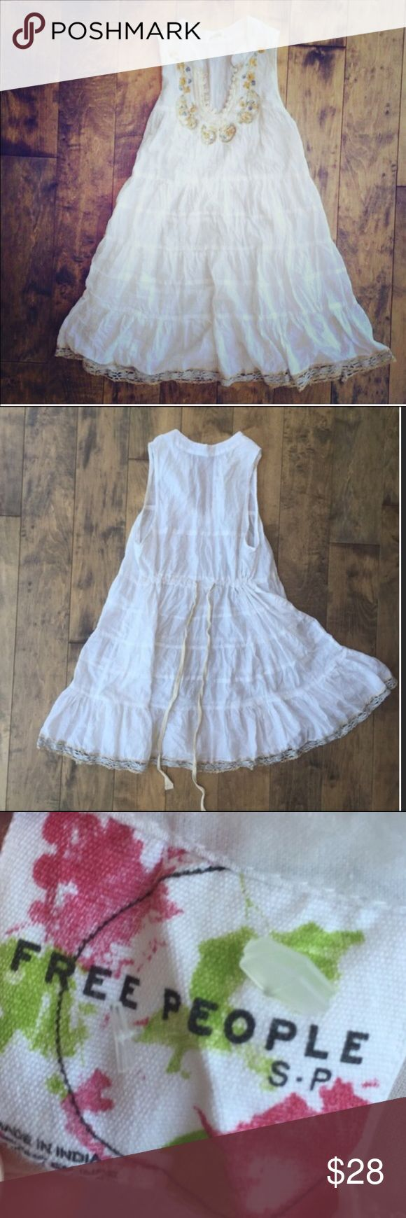 Free People White Embellished Dress Free People embellished white dress. Worn and washed a few times but in great condition. Soft and light weight. Great as is or over leggings! Free People Dresses Midi