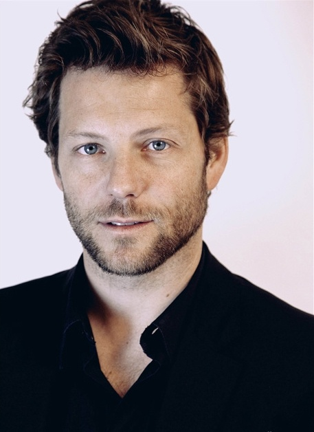 Jamie Bamber. He's British. Is there something in the water in Europe?
