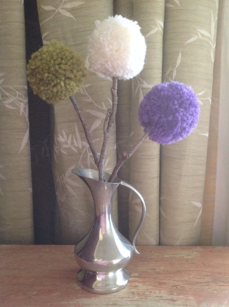 Pom Pom flowers with flowering gum twigs. Pom poms made with pure wool.