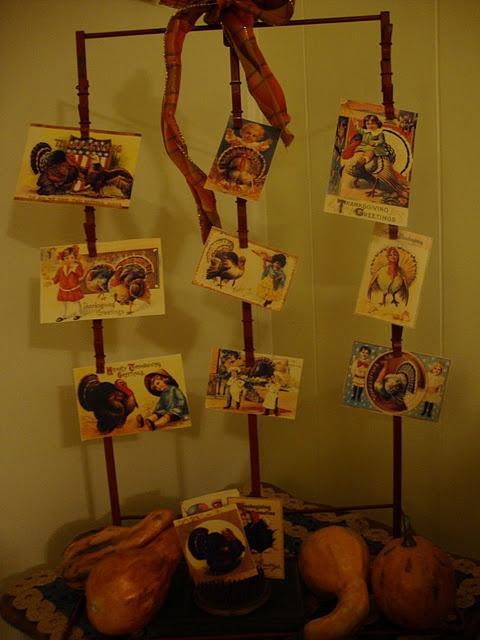 Vintage chip display rack with seasonal old postcards