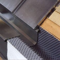 Constructive detail of a hidden gutter. Consists of three components: the VMZinc zinc tray; the high density polyethylene membrane Delta VMZinc and the fixing anchors.