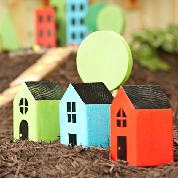 Wood block houses and trees for kids backyard play