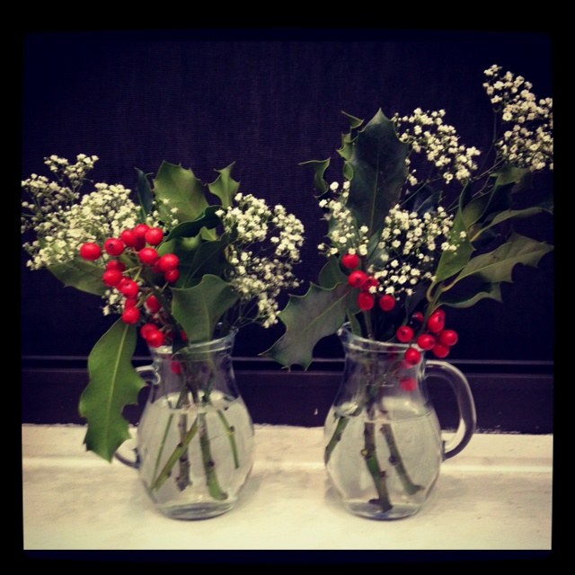 Simple Christmas flower arrangement in clear glass creamers. Photo by @KatieBlaine
