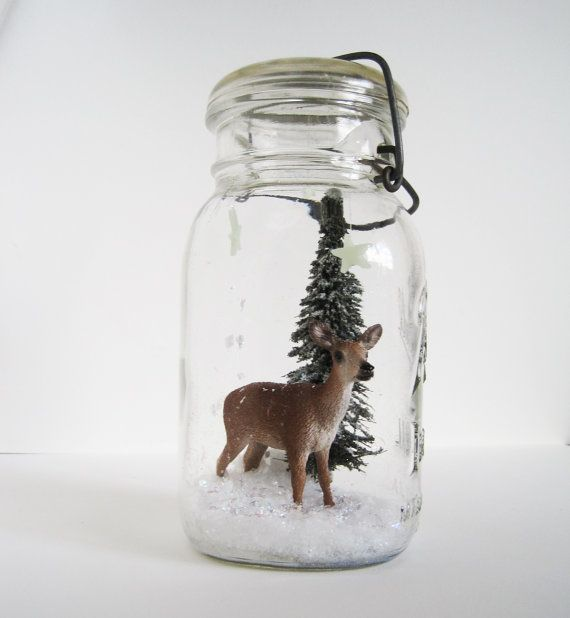 woodland christmas decor: diorama of a deer, snow, and pine tree in a vintage Ball jarby joyfulstudio