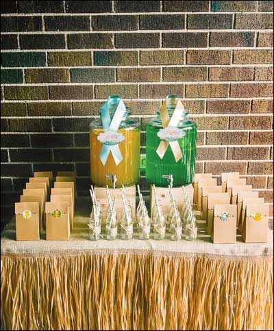 I really like the grass skirt around the table.  A burlap for the table cloth?