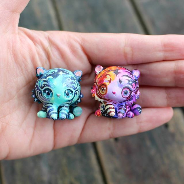 Hi everyone, here are the two galaxy tigers that I'll be putting up for auction! One will be for today (25 Sept NZ) ending tomorrow and the other will be starting tomorrow ending the day after- I'll put the specific times and days on the auction pictures- I think we'll go left to right so turquoise one first. In NZ we just went to daylight savings so I was...a little more confused than usualbut I think we good now