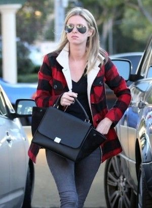 Nicky Hilton with Celine Black Trapeze Bag with Suede wings ...