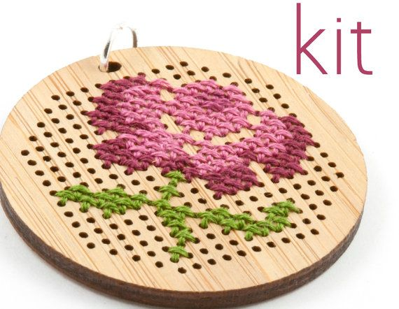 Love this flower motif stitched on a round bamboo pendant