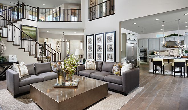 A dramatic two-story ceiling adds to the glamour of this elegant great room in Las Vegas, NV | Heidi plan by Richmond American