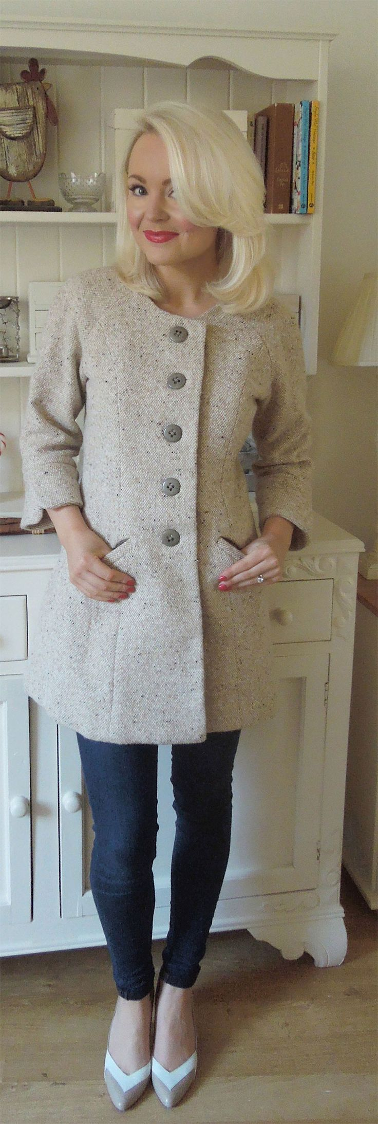 This is the coat I want to create with the wool coat I now have (that used to be one side of a reversible coat that I took apart and am attempting to tailor. With one exception I would make the sleeves full length.  I love it!