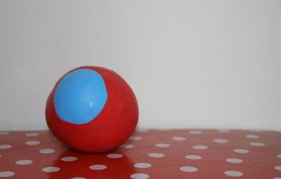 easy peasy juggling balls.  rice   + 2 balloons.  good party present