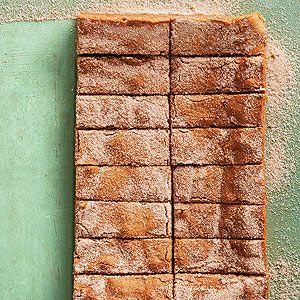These simple cinnamon bars keep for a month in the freezer. And with a cinnamon-sugar coat on top, you're going to want to keep these on hand for when you're craving fall desserts.