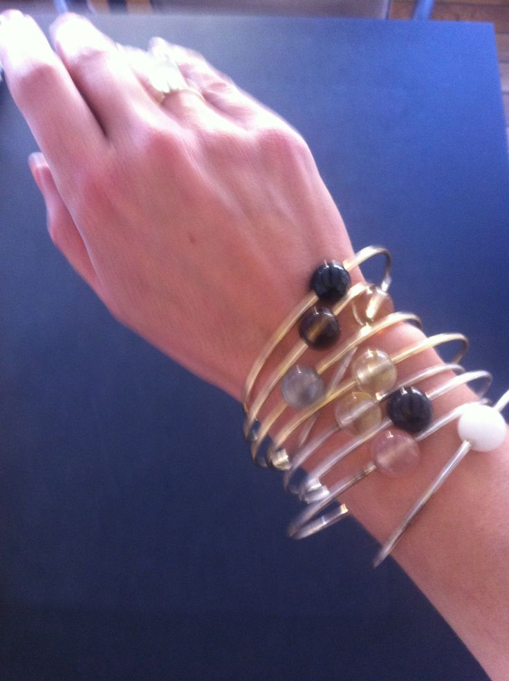 Sphere in Orbit bangles Power bracelets with magic gems on gold