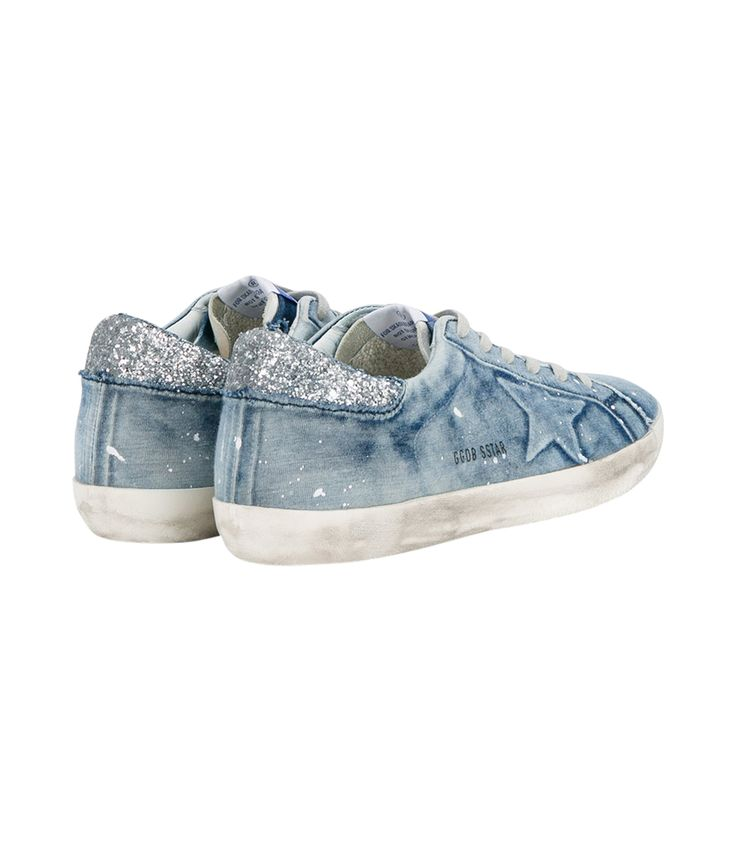 Blue sneaker featuring faded denim upper with rubber sole, terry cloth lined and glitter coated detail on back. ShopBAZAAR, shop designer clothing, shoes and accessories selected exclusively by the editors at Harper's Bazaar.