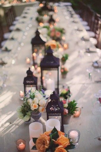 Garden chic low groupings of candlelight and flowers