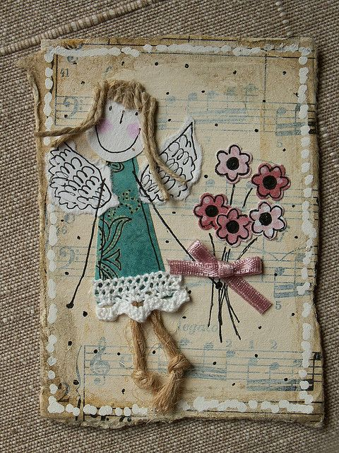 Collage, scrap fabric  lace, burlap, old books cut shape, a little paint and some real imagination!