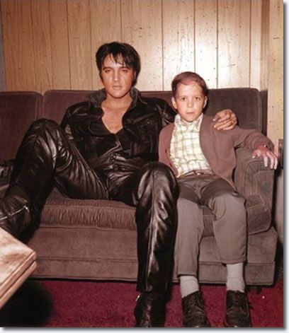 Elvis relaxing backstage with a young boy--1968 Elvis Comeback Special for NBC
