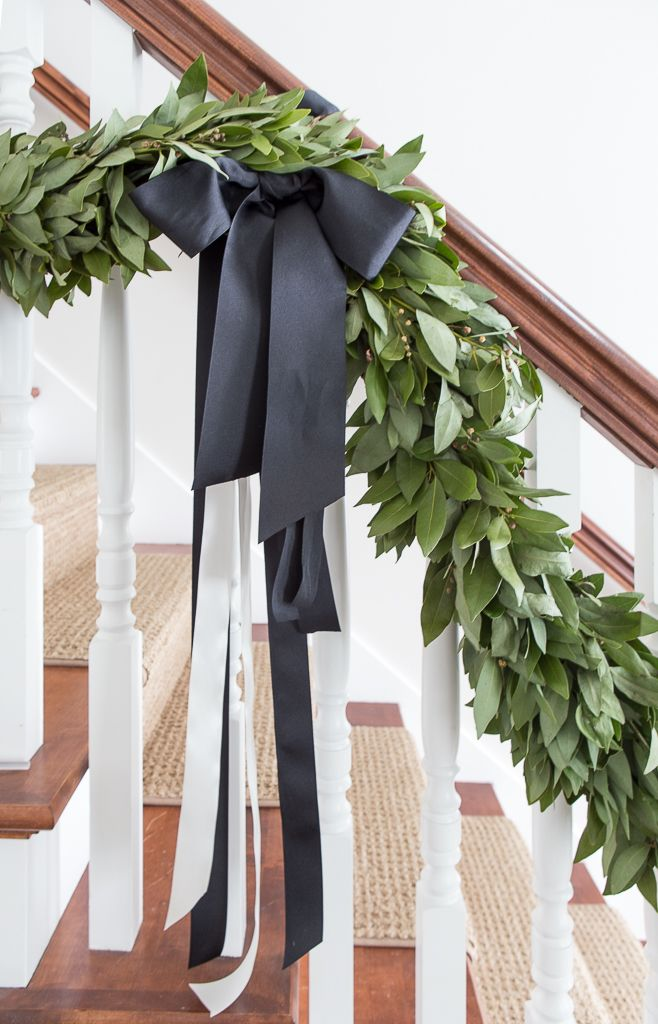 Christmas garland with bay leaf wreath and black ribbon