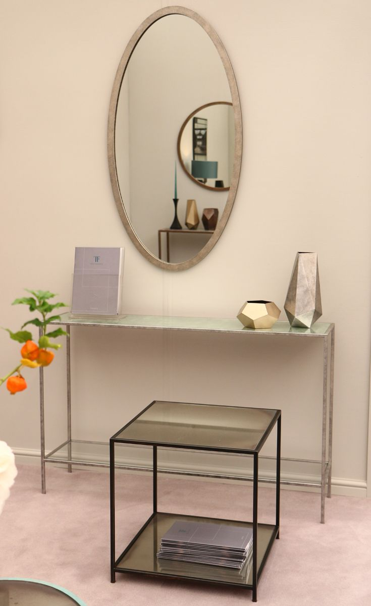 Avenues collection at #decorex 2015 featuring #metal #console_tables, #coffee_tables and #side_tables with #marble and #glass tops.