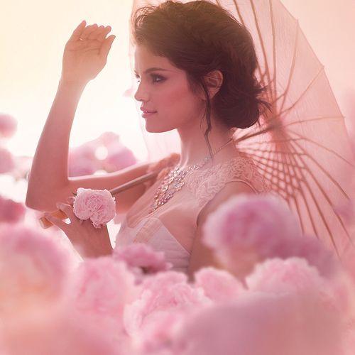 Selena Gomez with parasol