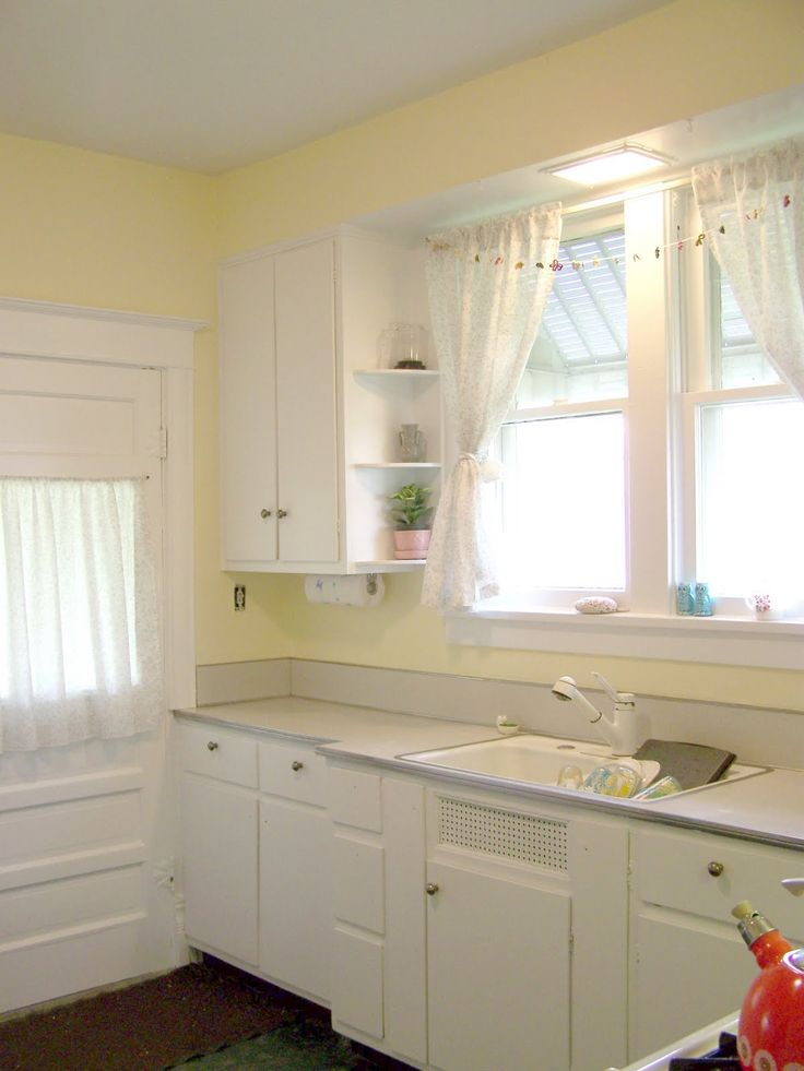 White and yellow kitchen for our house at the lake for Kitchenette cabinets