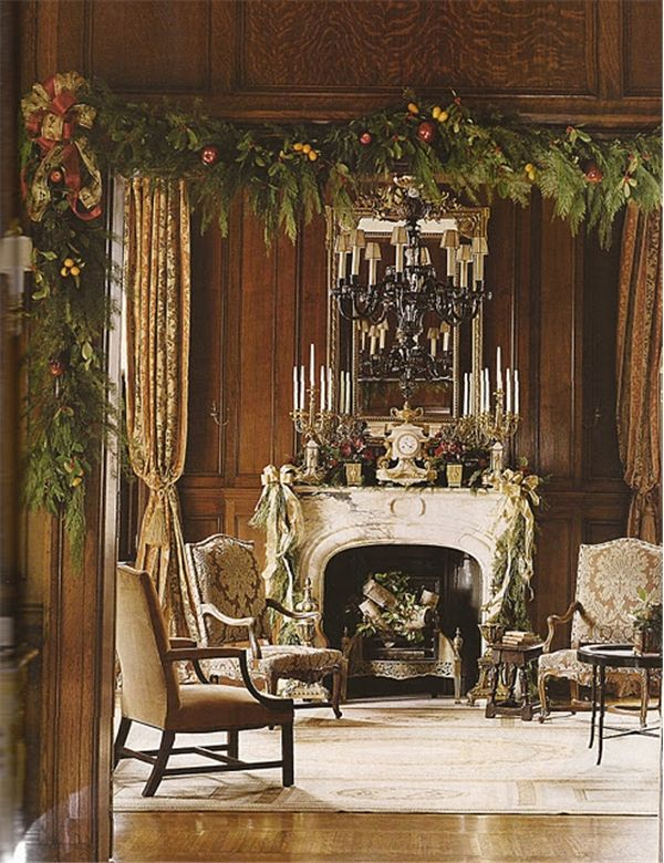 Asmara's Malmaison neoclassical needlepoint rug contains gold, cream and charcoal greys which resonate with the cream and grey marble fireplace and the gold and cream damask chair fabric and gold drapes. Southern Accents Magazine image via Cote de Texas blog