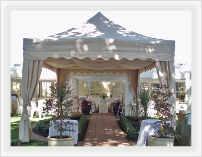 This style of entry into the marquee only think of it as completely decorated in mad hatter theming. Google Image Result for http://www.aussiemarquees.com.au/images/uploads/marquee-with-border.jpg