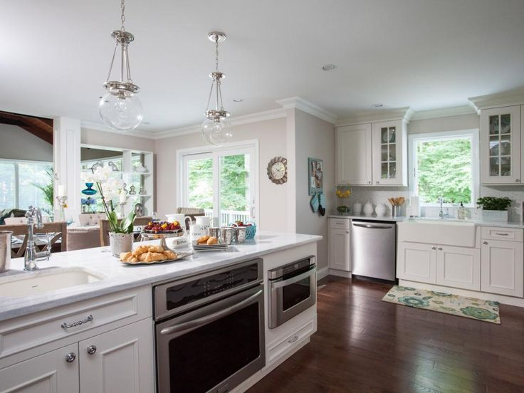 Not only does the new island create a natural barrier between the kitchen and dining room, but it also adds ample storage and a food prep-zone.