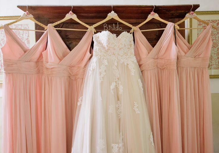 Light pink and off-white wedding dresses. Specially designed coat-hangers for the girls as a cute little touch.