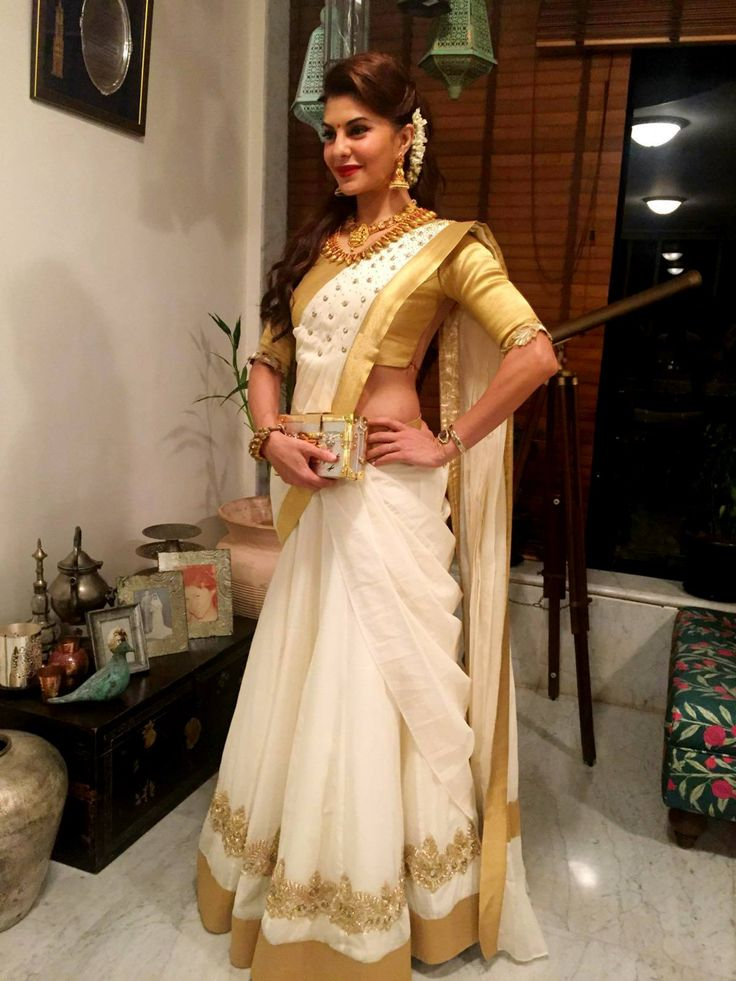 like the way dupatta has been tucked at waist. Jacqueline Fernandez in a Poornima Indrajith Kerala style lehenga